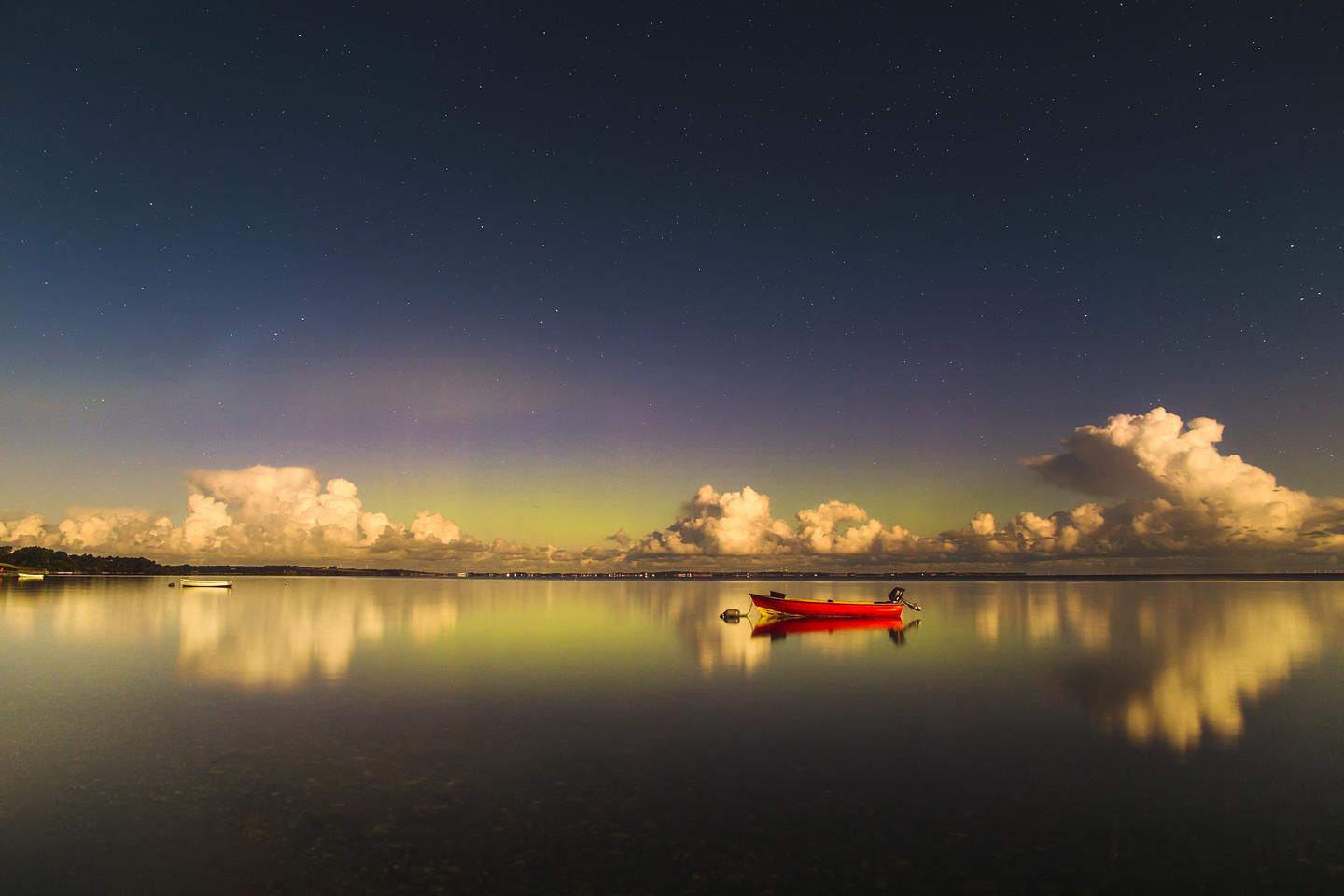 The Return of Green Lady, Highly Commended in the Aurorae category. When the photographer arrived at the Limfjord, he wasn't expecting to capture any aurora due to the strong light from the full Moon but he was pleasantly surprised when a green cast appeared on the camera screen. Nykøbing Mors, Nordjylland, Denmark