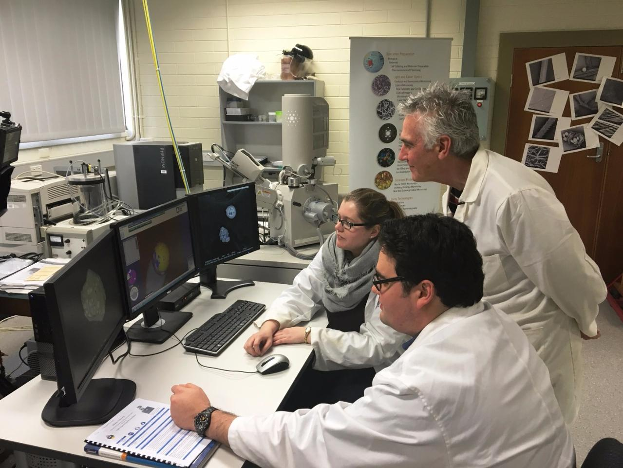 Professor Paul Kirkbride with his PhD students, Nick Lucas and Kelsey Seyfang, in their lab at Flinders University