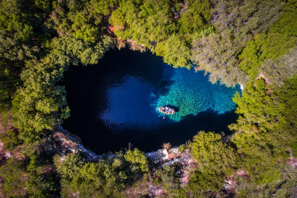 This shot shows Melissani Cave on the Greek island of Kefalonia from above