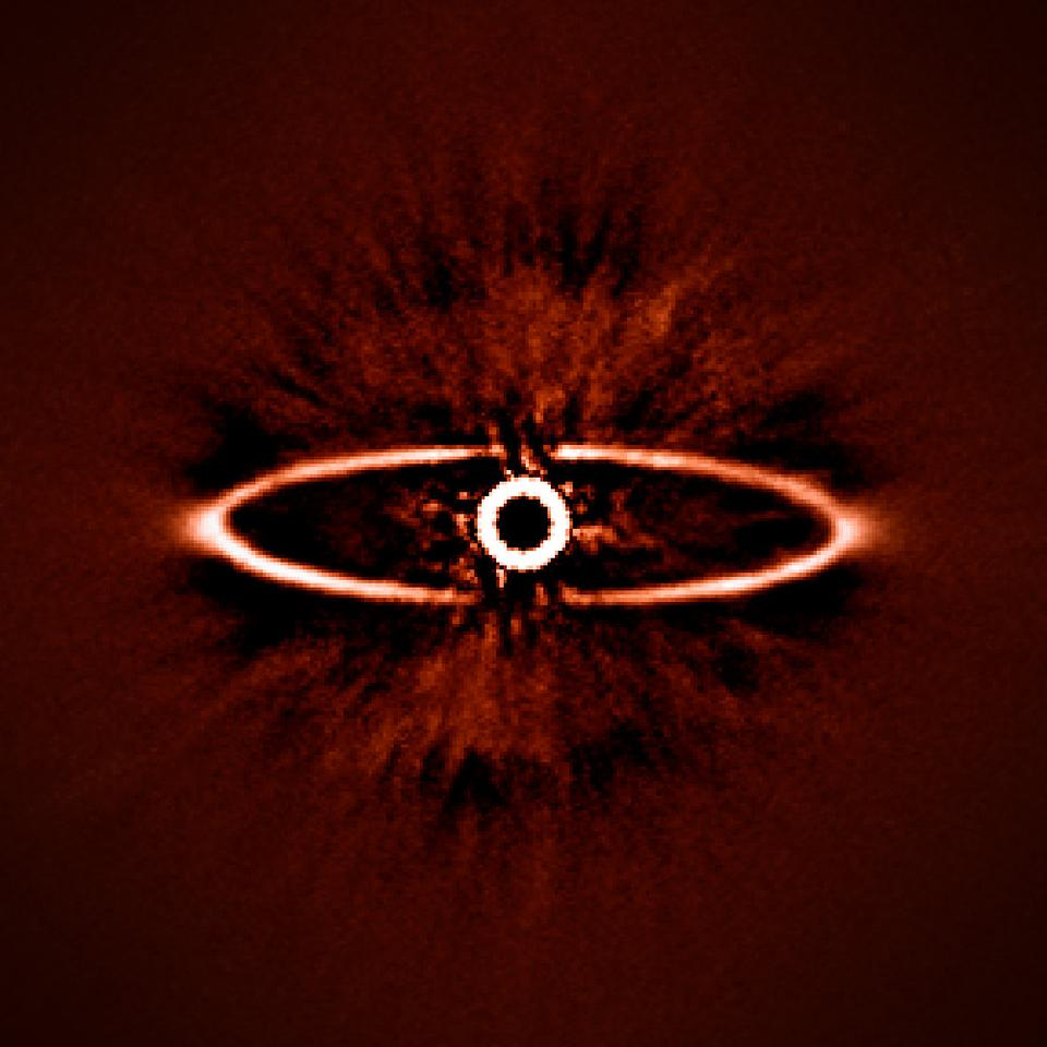 This infrared image, one of the first taken by SPHERE, displays a dust ring orbiting a nearby star designated HR 4796A (Image: ESO/J.-L. Beuzit et al./SPHERE Consortium)