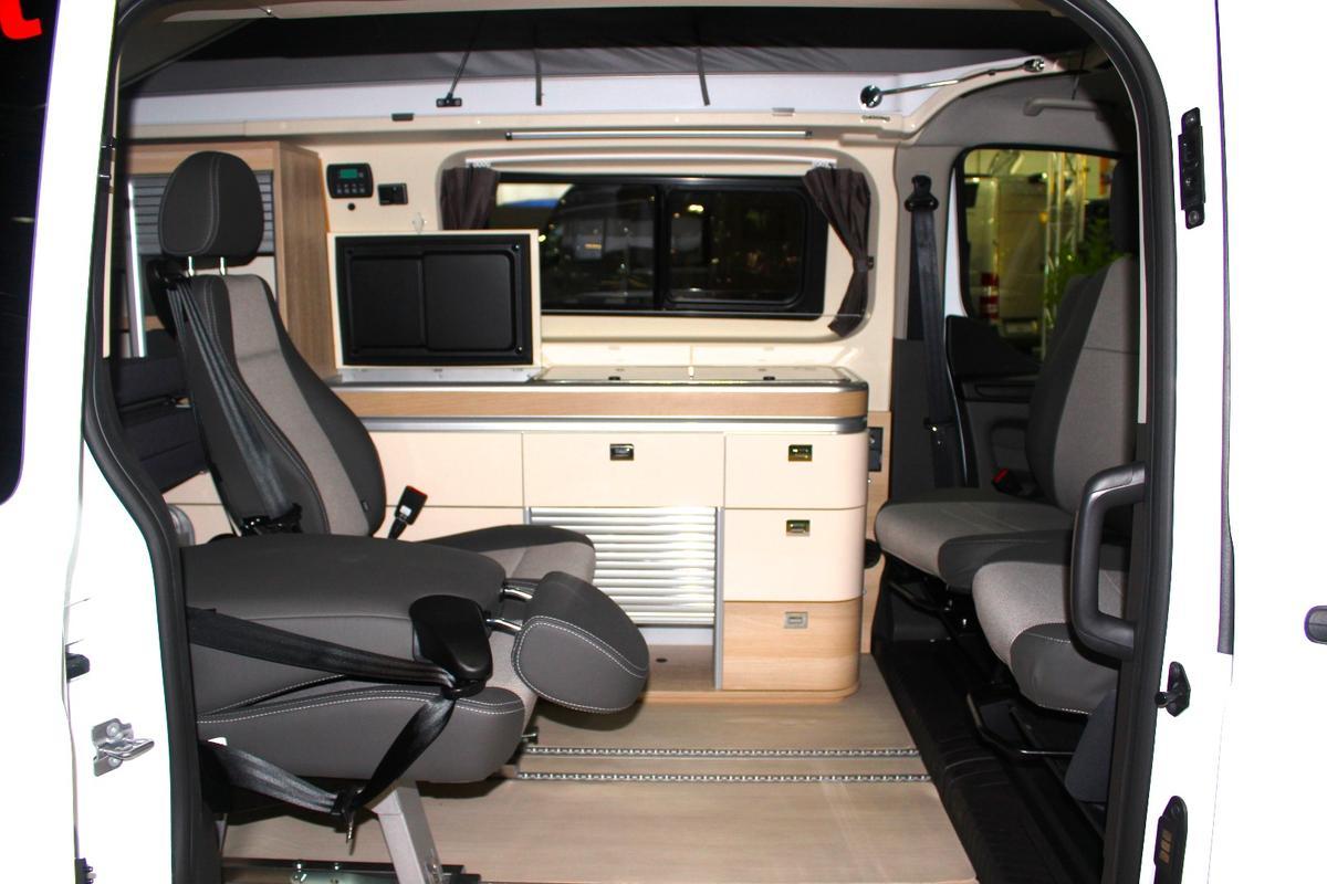 A peek inside the Dreamer Cap Coast Select atits folding rear seats, driver-side kitchen block and swivel front seats