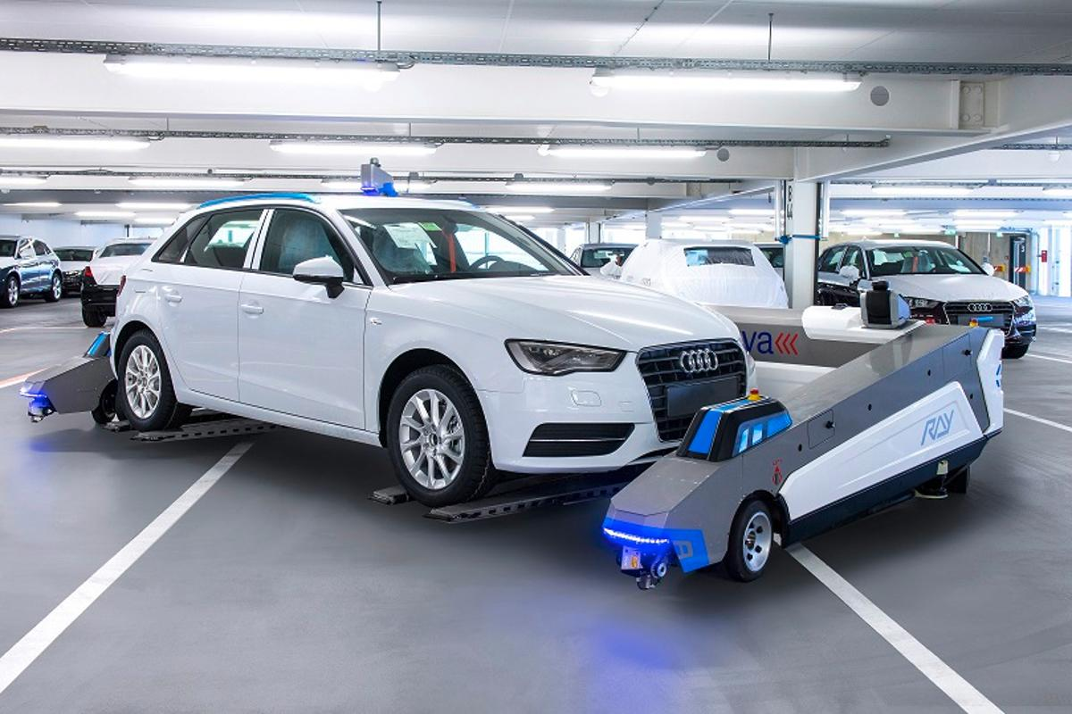 Audi is piloting autonomous robots in its Ingolstadt plant to move cars out of the way until they're needed