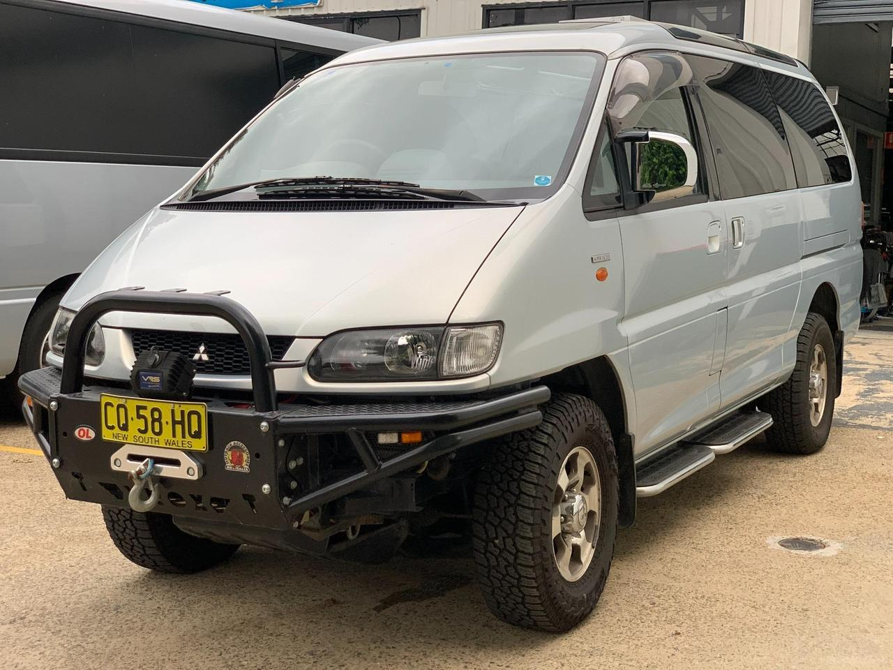 The 2003 Delica gets a little rougher and tougher thanks to its off-road bumper with bull bar and winch