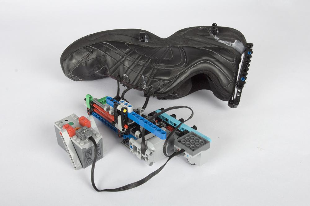 The Lego winding mechanism of the self-lacing shoe hack can be attached, removed and modified