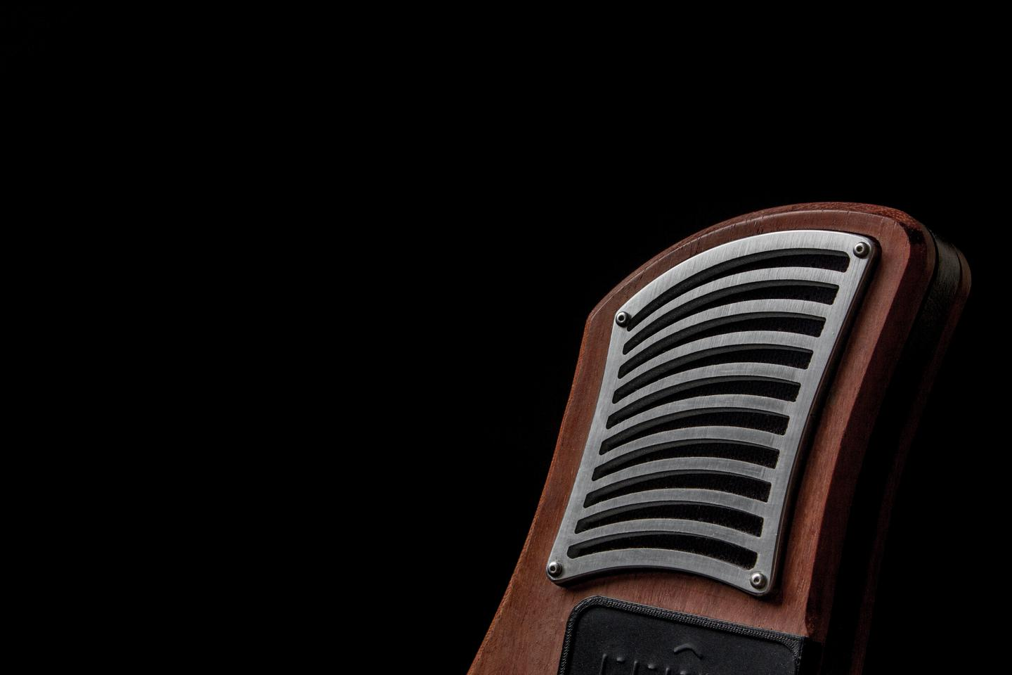 At either end of the ergonomic body fashioned from sustainably-harvested hardwoods and bamboo are BMR speakers