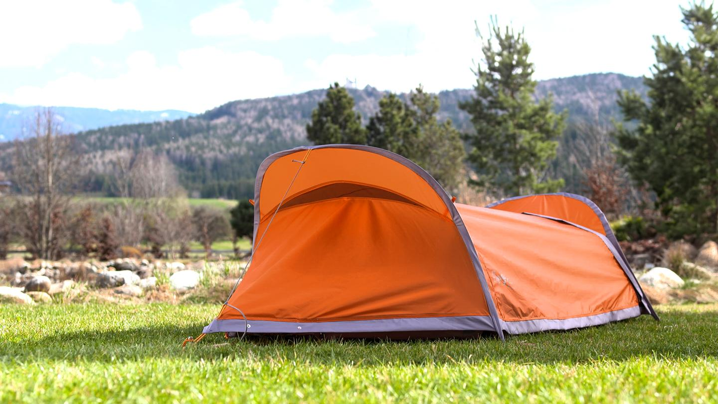 The Flying Tent stakes quickly, making a one-person tent with mosquito netting and rain fly