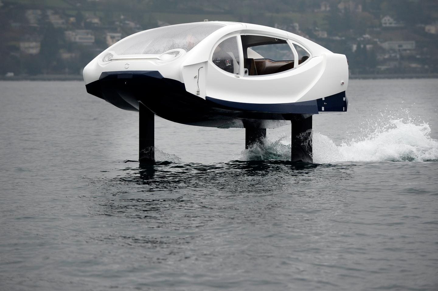 Riding high: this electric hydrofoiling bubble sits some 18 inches over the water
