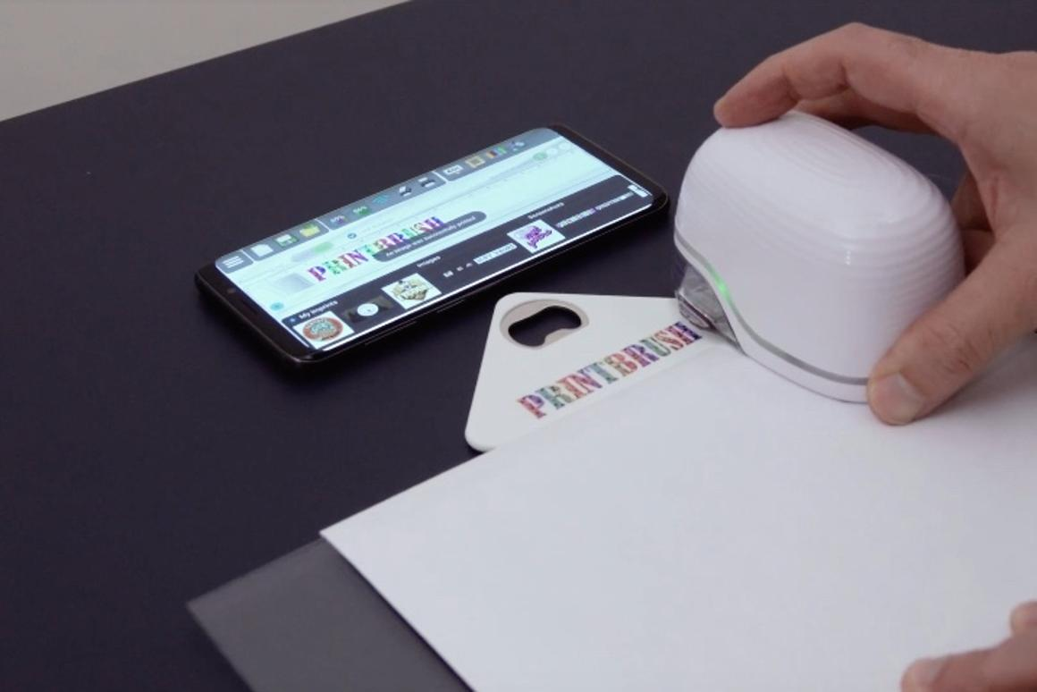 The PrintBrush XDR applies graphics to a bottle opener