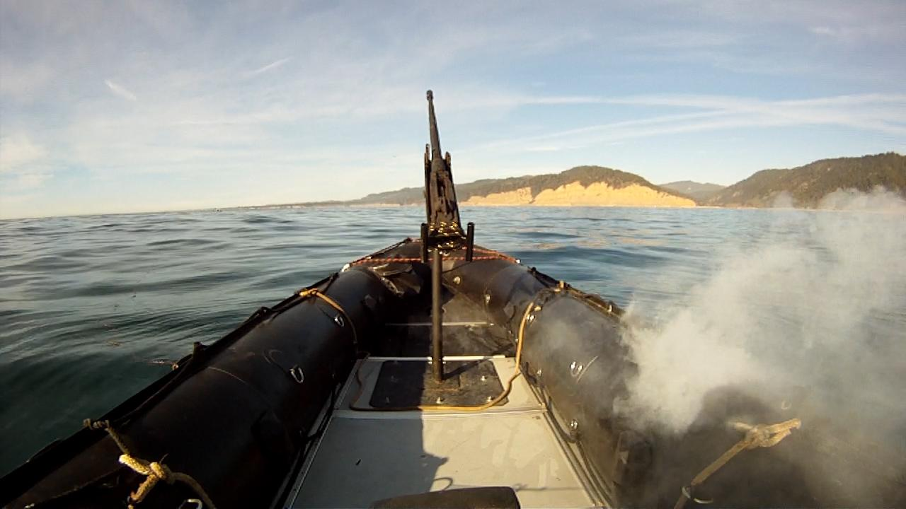 The Lockheed Martin ADAM laser system burns through the hull of a military-grade boat