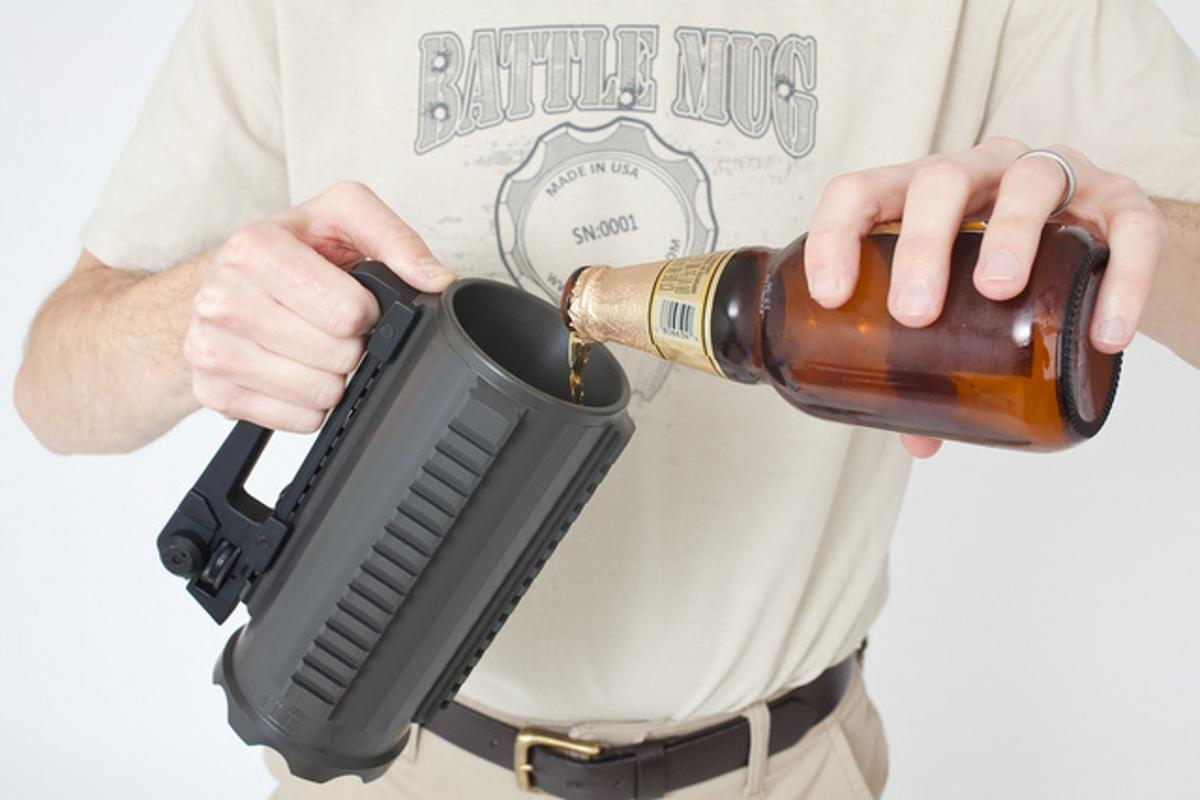 The Battle Mug is made from a solid block of aluminum, features a handle from an AR-15 rifle, and has mounting rails for accessories such as night-vision scopes