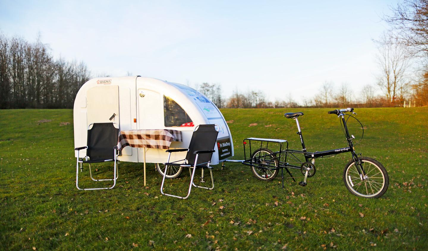 There are lots of optional extras available, including different colors, a solar power package, kitchen, and extra bicycle attachment (Photo: Wide Path Camper)