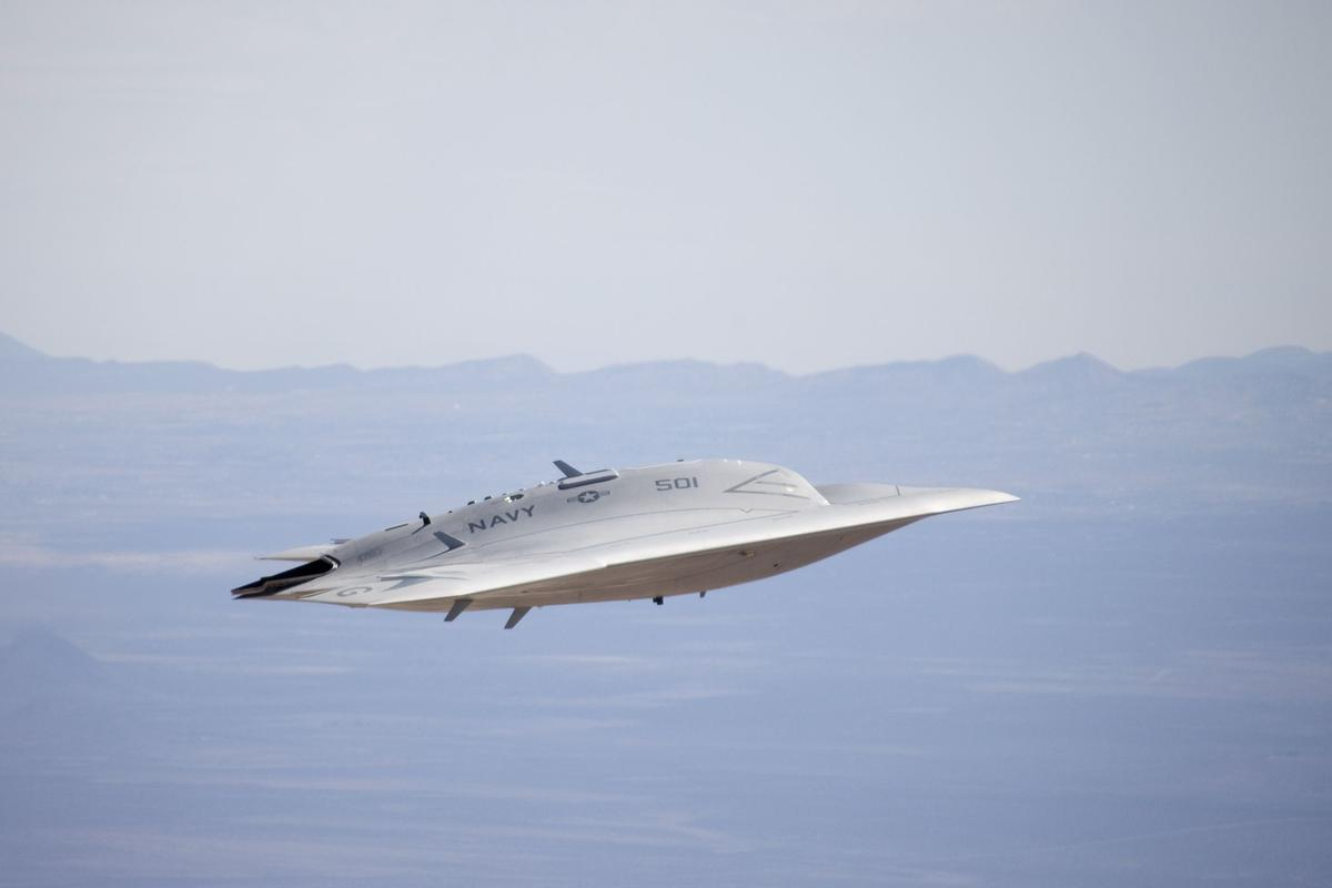 The X-47B Unmanned Combat Air System flying with its landing gear up during a test flight at Edwards AFB, Calif.