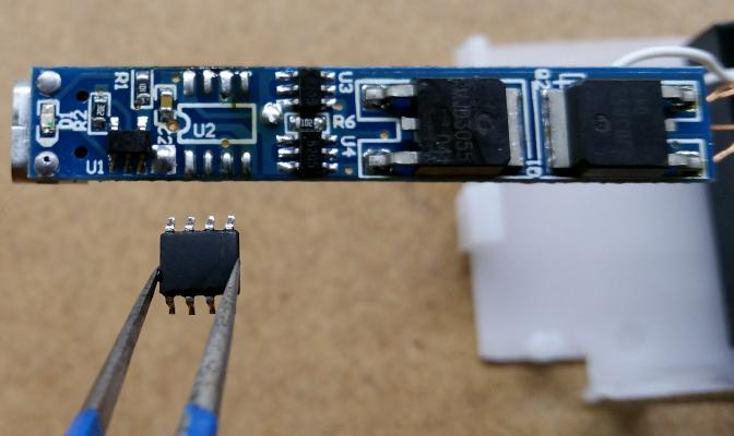 A pin-compatible PIC12F1840 microcontroller was mounted to the dual-arc lighter's PCB