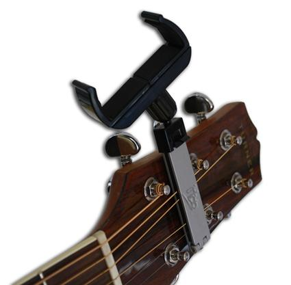 The headmount clips over the strings of the guitar's headstock so that the device is always within easy reach