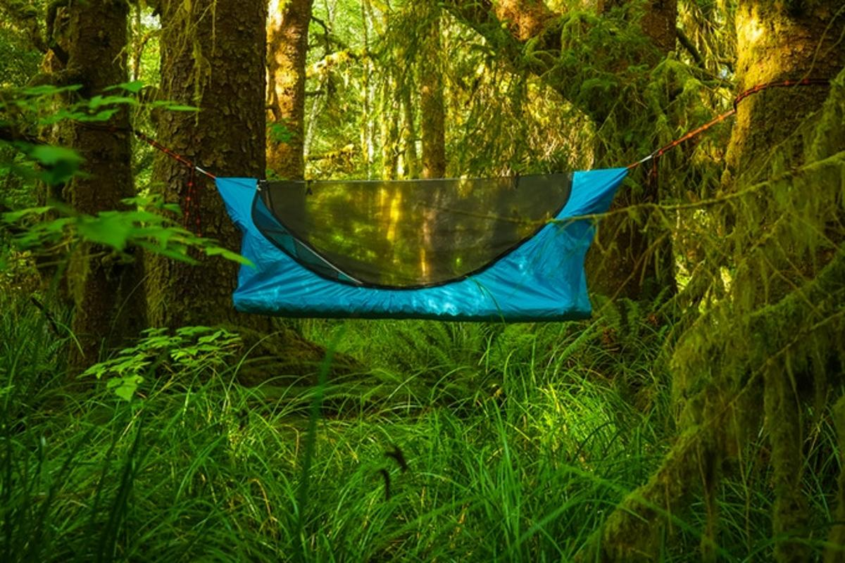 The Haven Tent can be suspended between two trees like a regular hammock, but offers occupants a flat sleeping platform thanks to an innovative design
