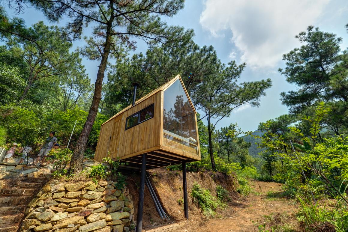 Vietnamese Forest House Puts Tiny Living On Stilts