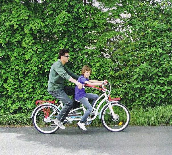 The Hugbike lets kids sit in front, while allowing parents to steer