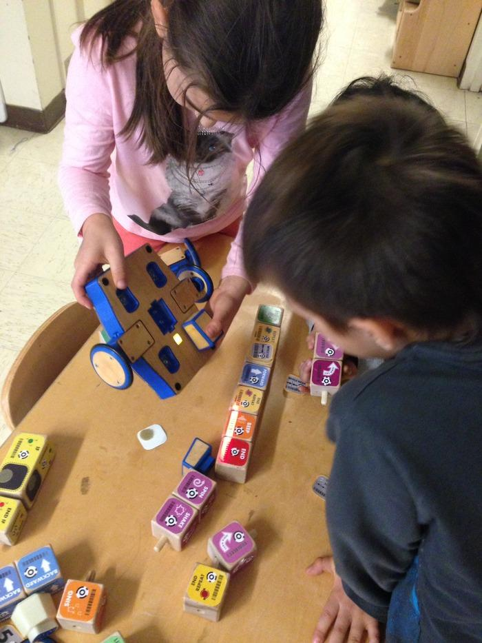 Kibo allows young tinkerers to build a robot using supplied modular components, personalize it with art designs and then program it to do their bidding using colored program blocks