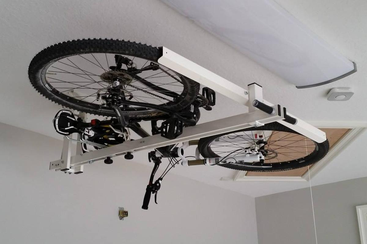 The flat-bike-lift utilizes pneumatic and hydraulic pistons, to make the pushing and pulling easier
