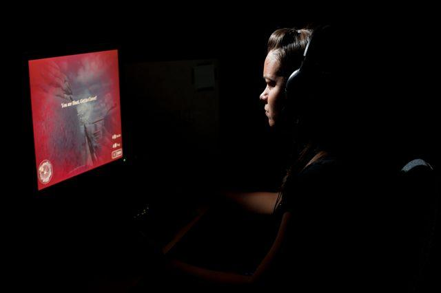 One of the test subjects playing an action video game (Photo: J. Adam Fenster, University of Rochester)
