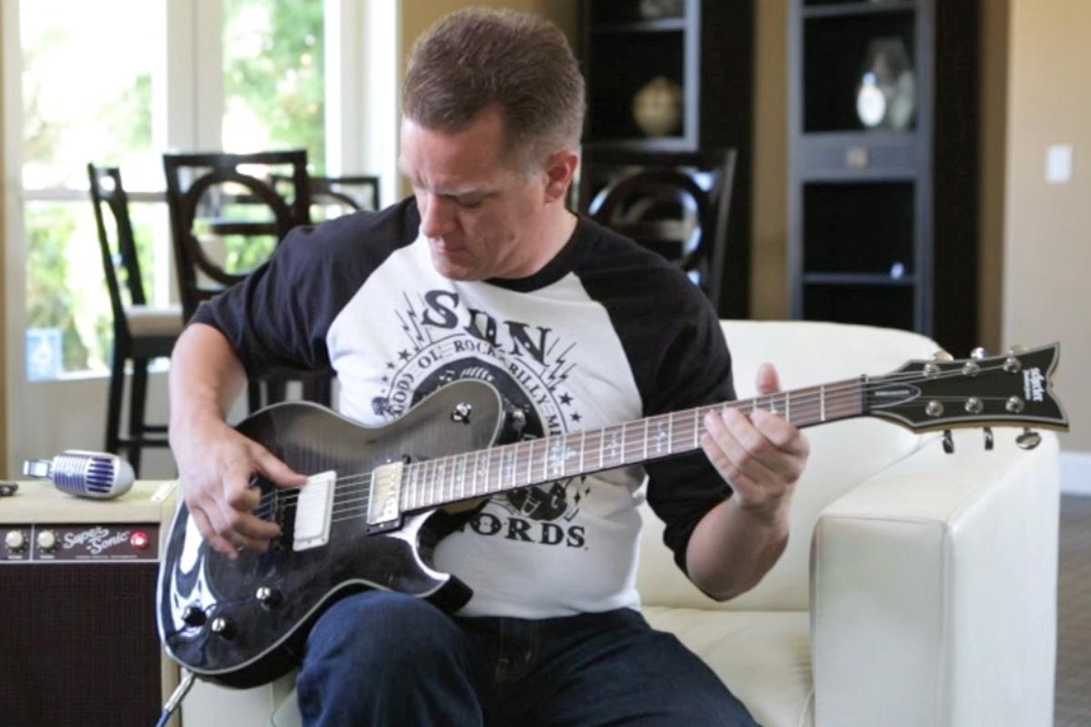 """Livermore-based guitarist Brandon McCullough tries out the Dialtone """"infinitely adjustable pickup"""""""