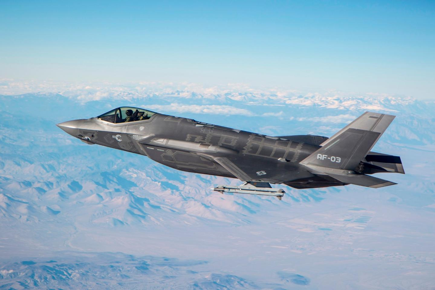 An F-35A conducts testing with an AIM-9X over the skies of California
