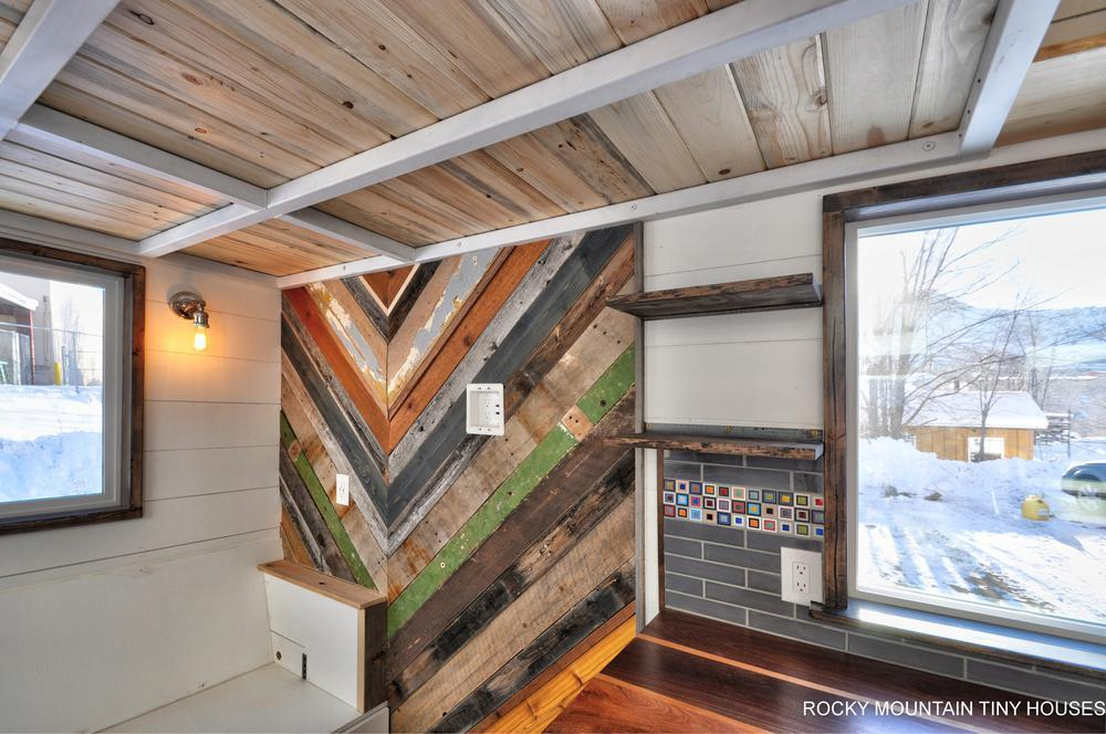 The Infinitely Stoked hasa featurewall made up of scrap siding, barn wood, and boards from a 1960 Ford F600 grain truck
