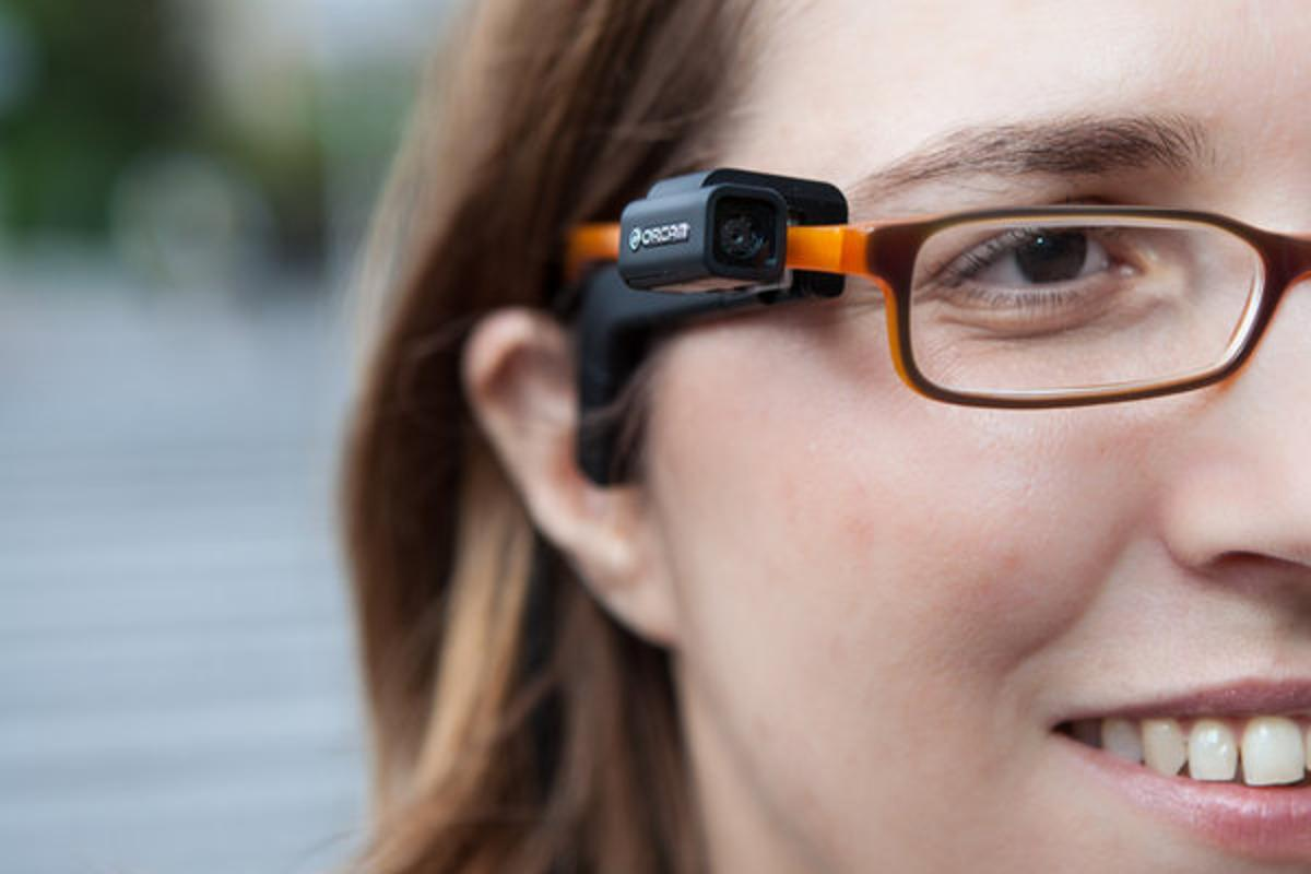 OrCam's camera device, attached to a pair of glasses by a small magnet (Photo: OrCam)