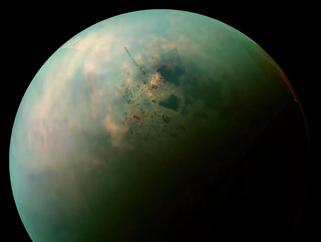 A near-infrared view of Titan's northern hemisphere, with the orange areas highlighting where crystals of butane and acetylene form as the weird oceans evaporate