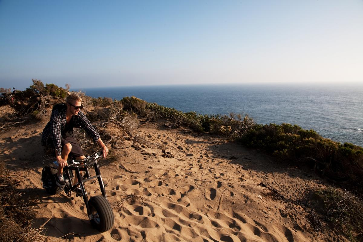 Those chunky tires help riders take sand dunes with ease