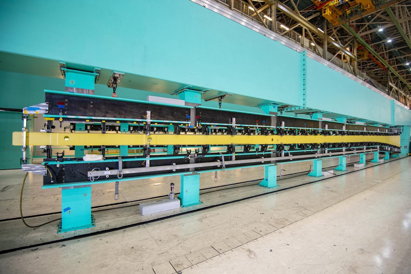 An 82.4-foot long 767 wing spar is loaded into a tool in Boeing's Everett, WA, factory, kicking off assembly of the first KC-46A tanker for Japan