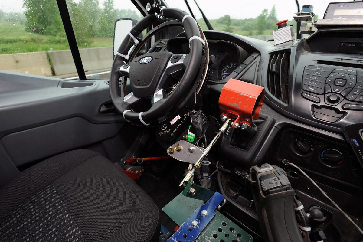 Ford's robotic testing system drives trucks and vans over test tracks without human drivers
