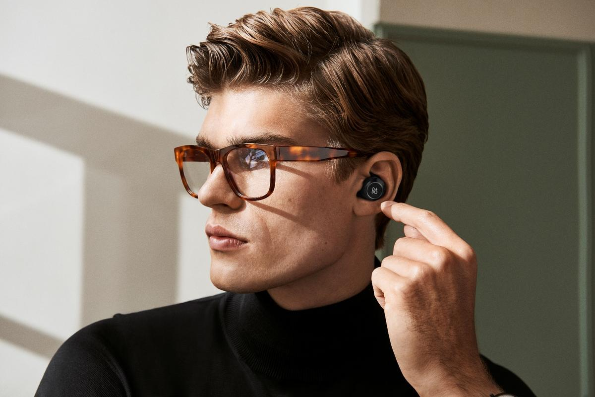The Beoplay E8 wireless earphones are controlled via a touch interface