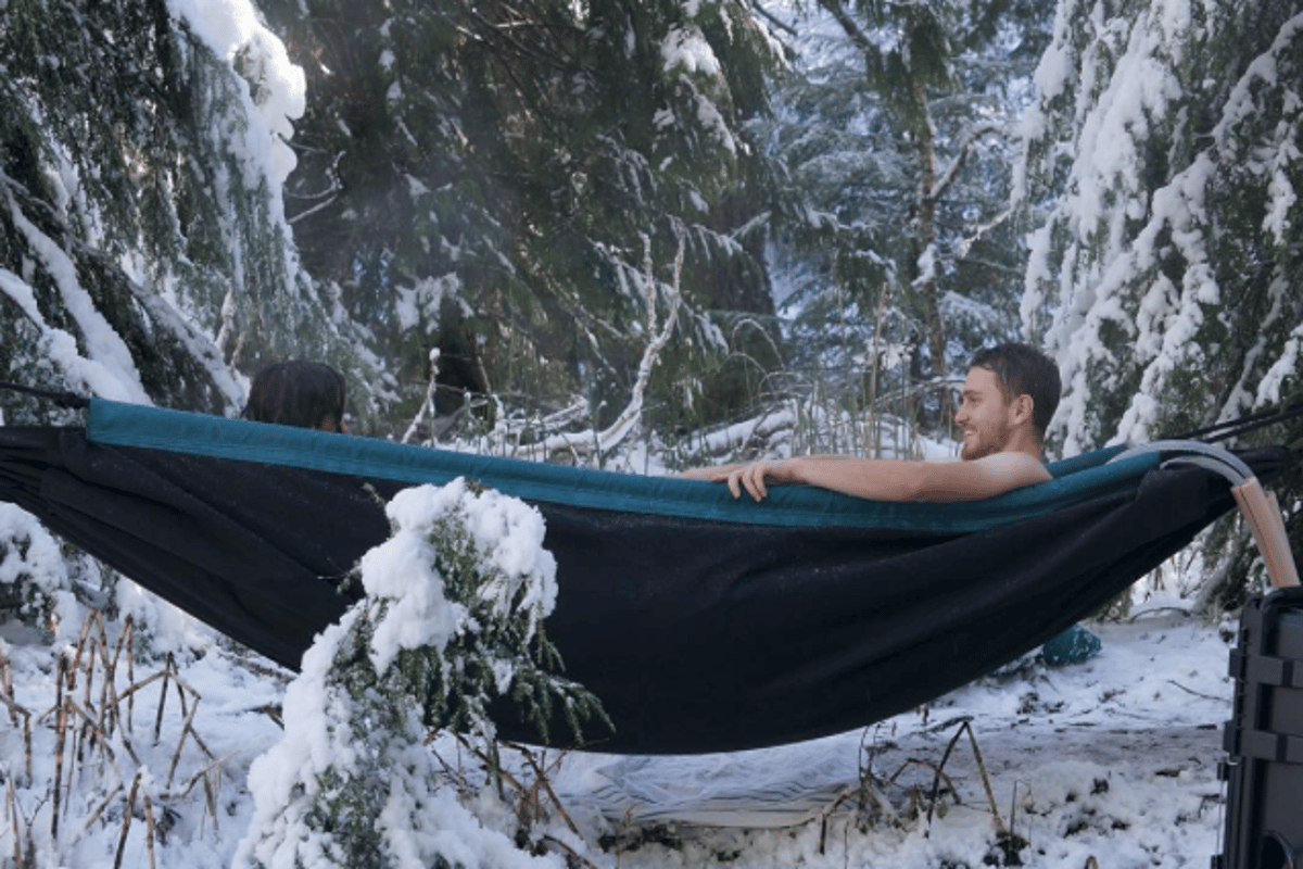 The HydroHammock serves as a portable hot tub for outdoor relaxation