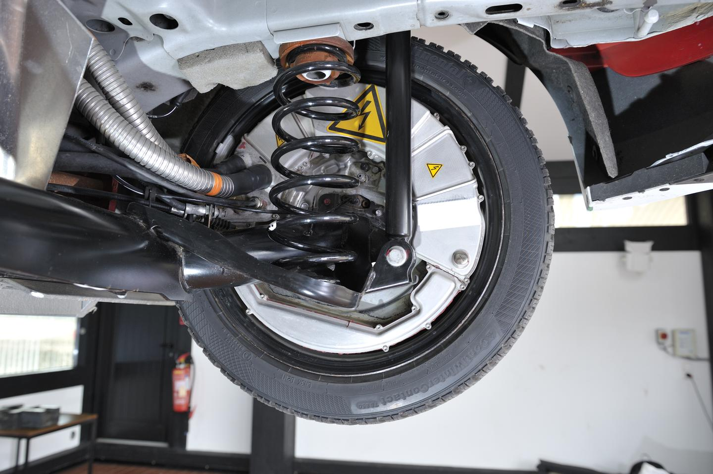Warning stickers mark the electric hub motors in the rear wheels