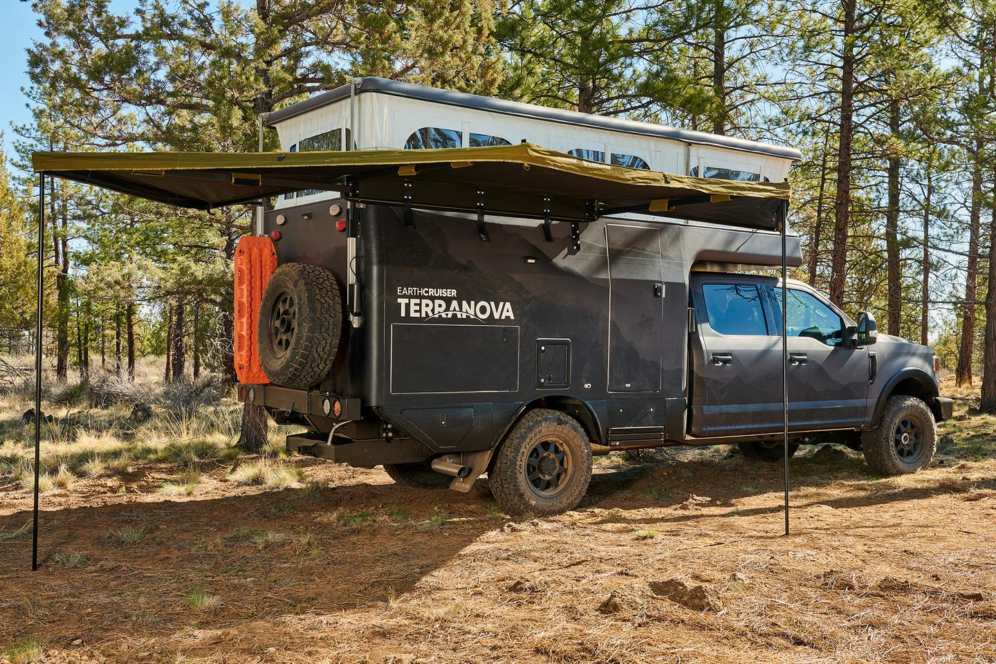 EarthCruiser Terranova with available awning set up and ready to camp