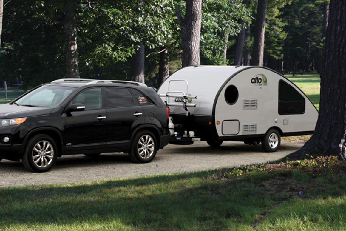 Compact teardrop trailer transforms into a large family camper