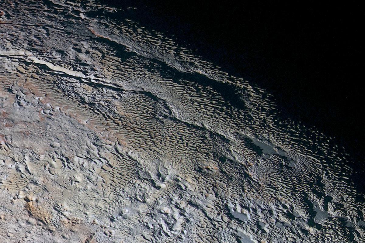High resolution image of the Tartarus Dorsa mountain range spanning 330 miles (530 km) across