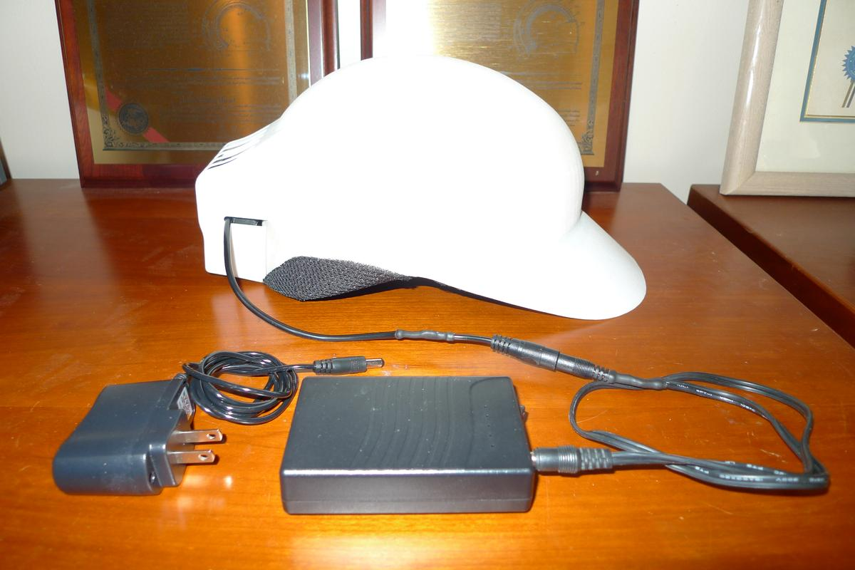 Prototype a/c baseball cap with its charging gear