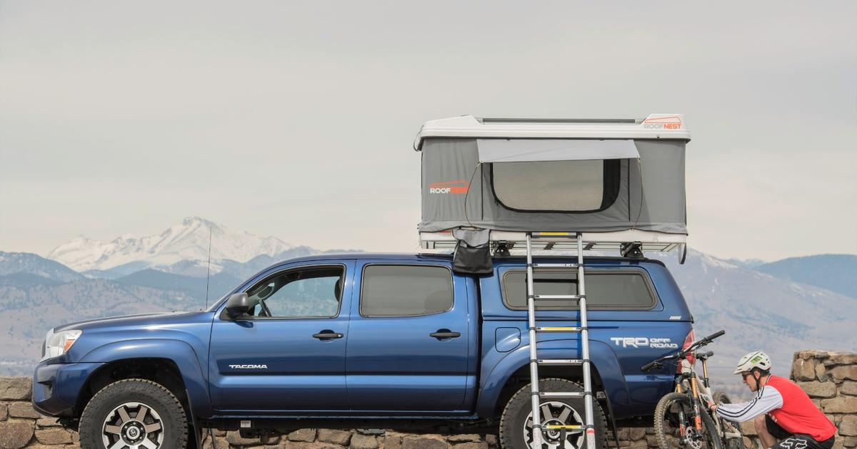 Roofnest Sandpiper roof-top tent carries bikes and shelter atop your car roof