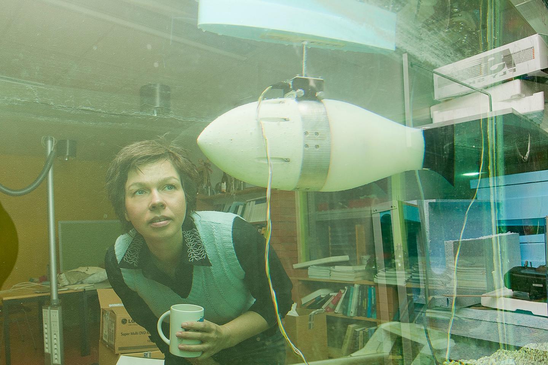 Tallinn University's Prof. Maarja Kruusmaa inspects one of the FILOSE robotic fish