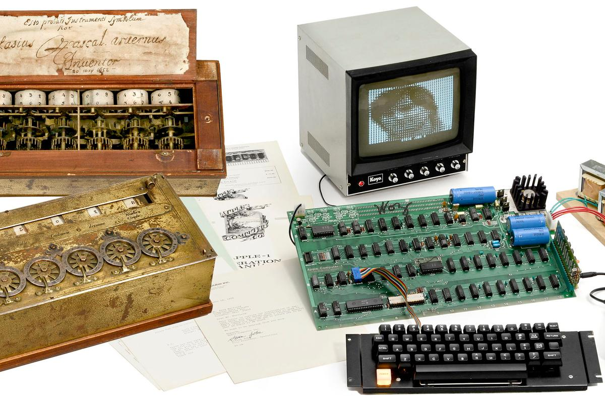 The Auction of Firsts includes an original Apple 1 computer from 1976, and a reproduction Pascaline mechanical calculator
