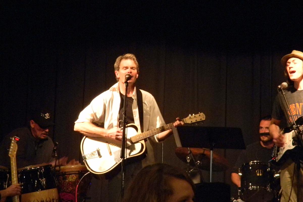 Guitarist Mike Rowell plays the Bouillez acoustic