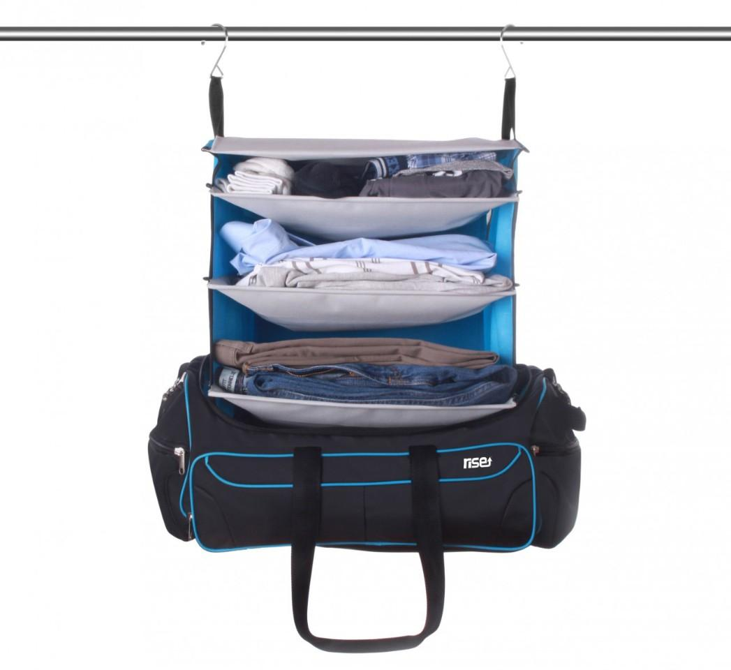 The Rise & Hang duffel bag features built-in collapsible soft shelves that pull up out of it, keeping your clothes organized and accessible