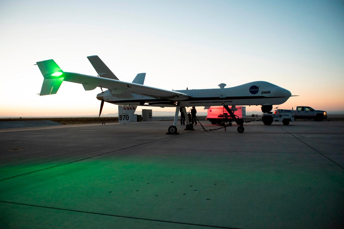 Aircraft maintenance crews at NASA's Armstrong Flight Research Center prepare the remotely-piloted Ikhana aircraft for a test flight June 12, 2018