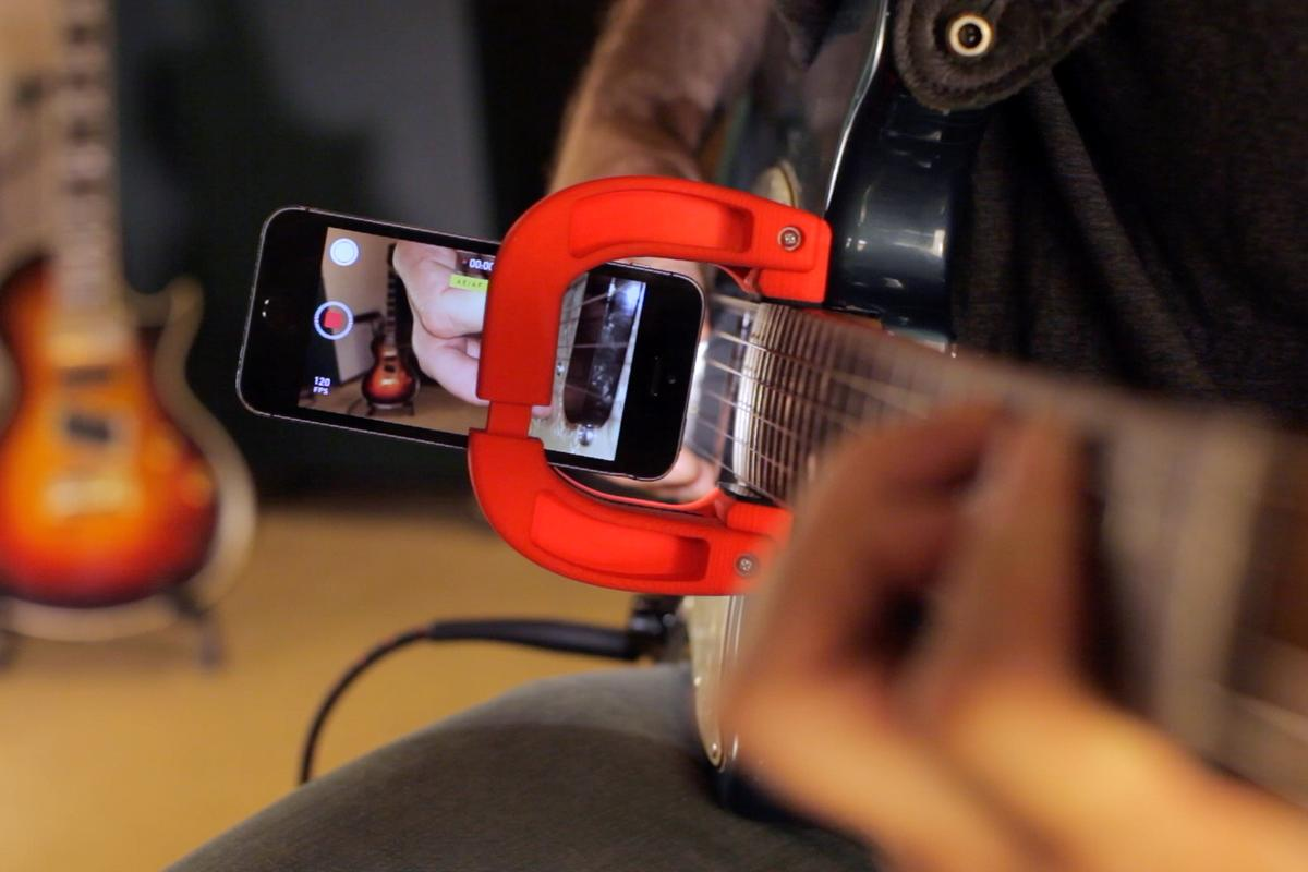 The Magnet allows a smartphone to record close up video footage of guitar playing