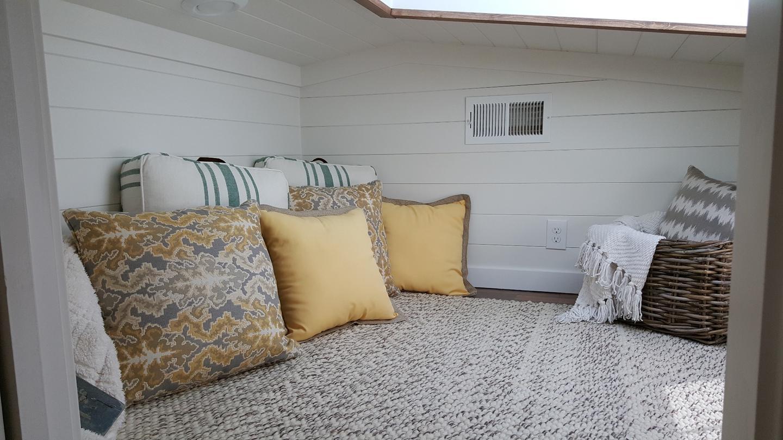 The Phoenix's bedroom is located in the gooseneck area of the trailer