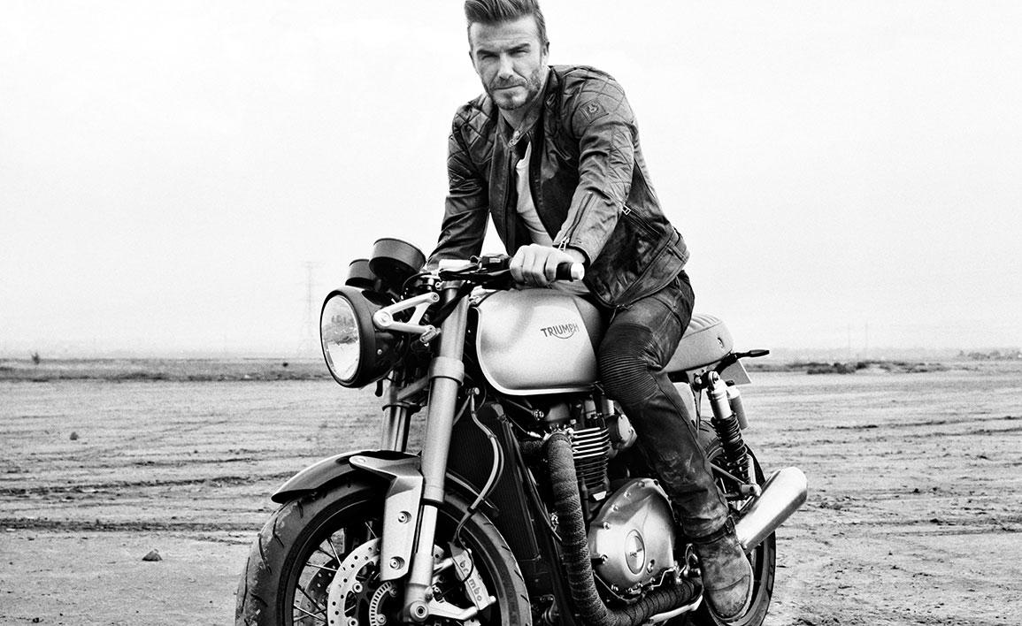 """David Beckham as the star of the """"Outlaws"""" film aboard a new cafe racer Bonnie gives us a clear indication of what Triumph is about to unveil – notice the radiator that is cleverly hidden between the frame downtubes"""