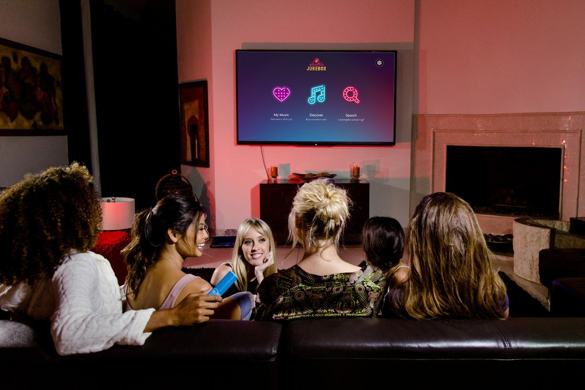 The Electric Jukebox brings family and friends around the living room TV to listen to streamed music
