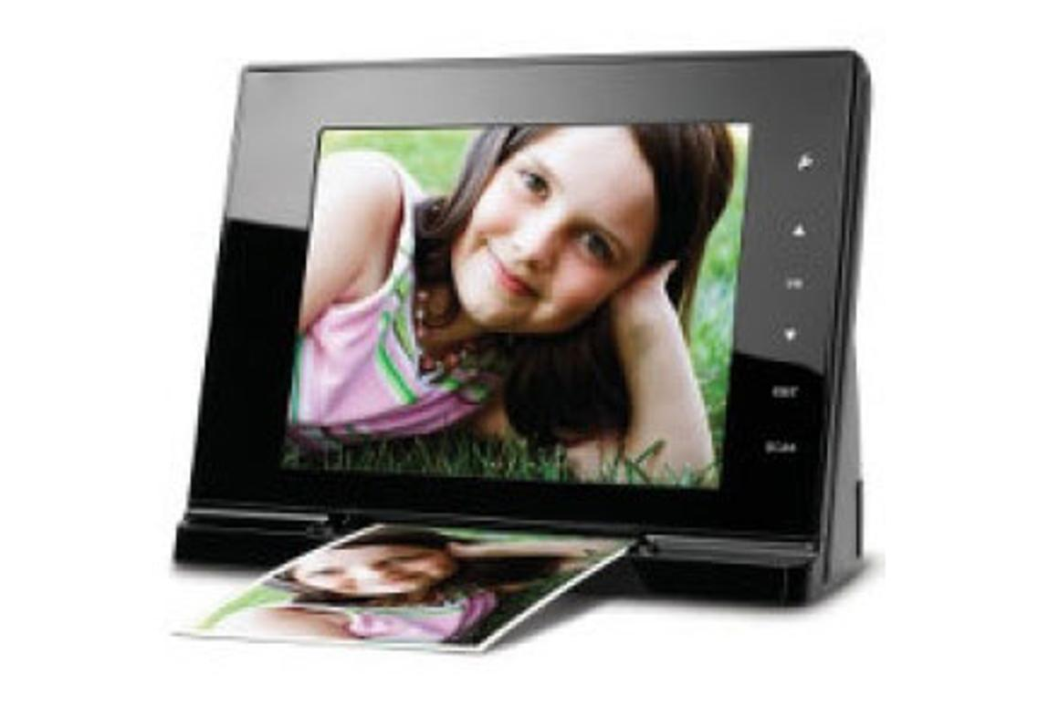 Hammacher Schlemmer's photo frame/scanner converts your old photos into 300-dpi jpg images with the press of a button